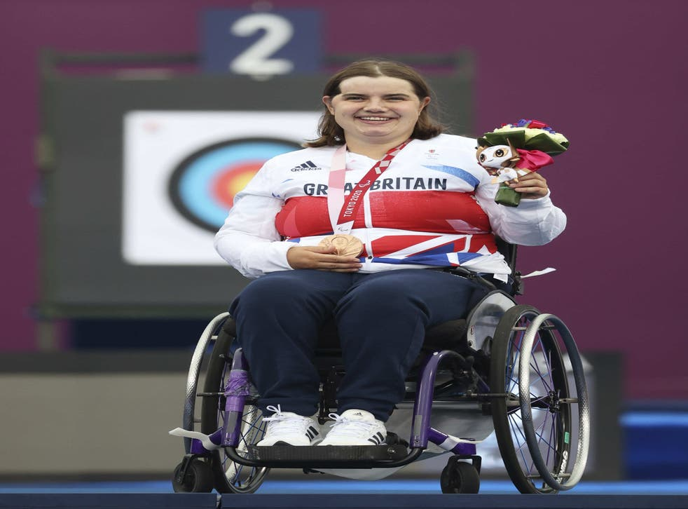 Great Britain's Victoria Rumary on the podium with her archery bronze medal (ParalympicsGB/imagecomms/PA)