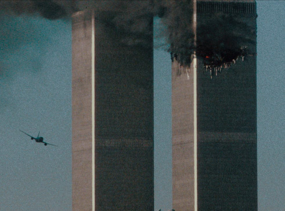 <p>A shot of the second hijacked airplane just seconds before it struck the South Tower in the 9/11 terror attacks</p>