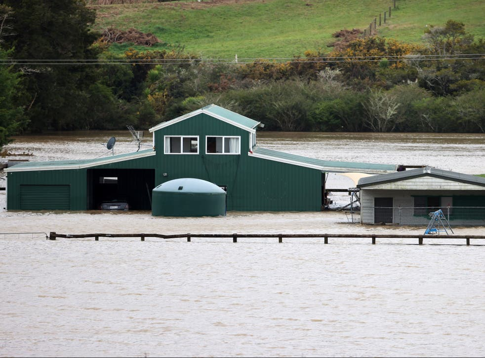 <p>Homes were evacuated in parts of Auckland after heavy rain caused flash flooding</p>