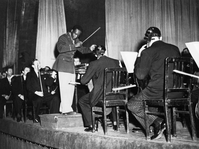 <p>Rudolph Dunbar leads the Berlin Philharmonic orchestra in 1945</p>