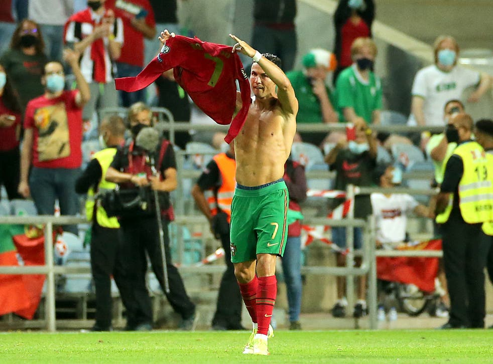 Portugal's Cristiano Ronaldo holds up his shirt to to the fans after scoring his sides second goal during the 2022 FIFA World Cup Qualifying match at the Estadio Algarve, Portugal. Picture date: Wednesday September 1, 2021.