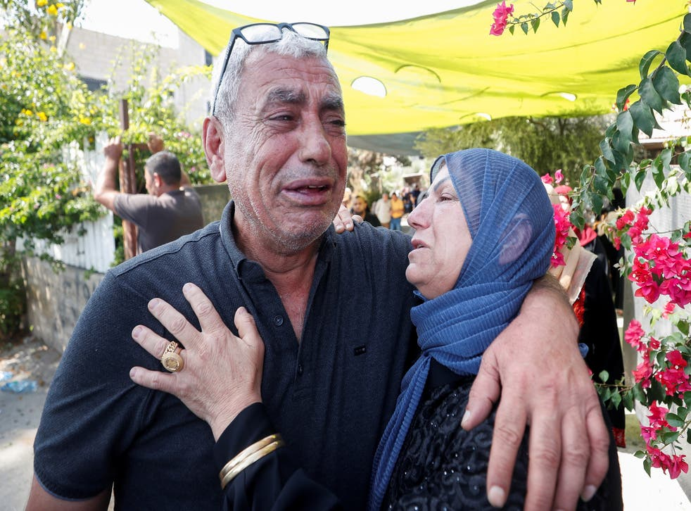 <p>Mourners cry during the funeral of Palestinian Raed Jadallah, who was shot dead by Israeli forces, according to health ministry, near Ramallah in the Israeli-occupied West Bank</p>