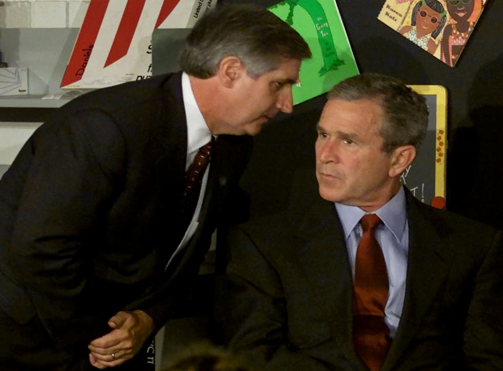 <p>US President George W Bush listens as White House Chief of Staff Andrew Card informs him of a second plane hitting the World Trade Centre </p>