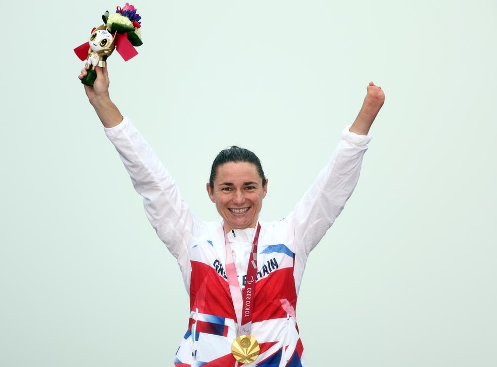 <p>Dame Sarah Storey celebrates her victory in the women's C4-5 road race</p>