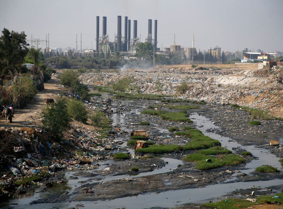 <p>Raw sewage flowing near the main Gaza Strip power plant, serving the Hamas-run Palestinian occupied territories, south of Gaza City in 2019</p>