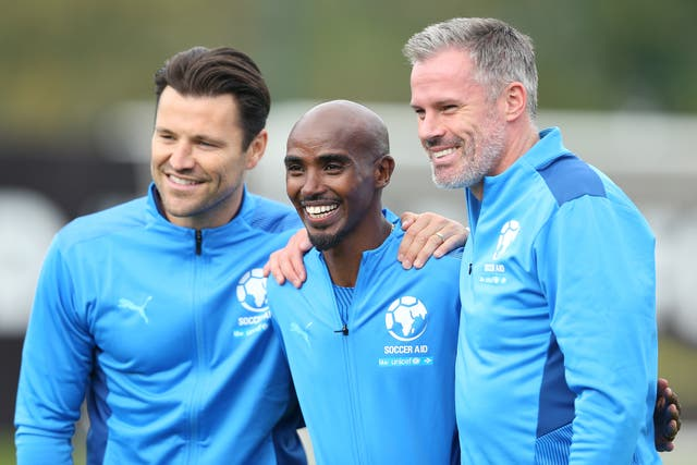 <p>Mark Wright, Sir Mo Farah and Jamie Carragher of England pose for a photograph prior to Soccer Aid</p>