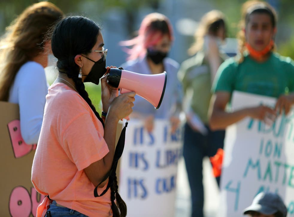 <p>Abortion rights supporters gather to protest Texas SB 8 in front of Edinburg City Hall on Wednesday, Sept. 1, 2021, in Edinburg, Texas</p>