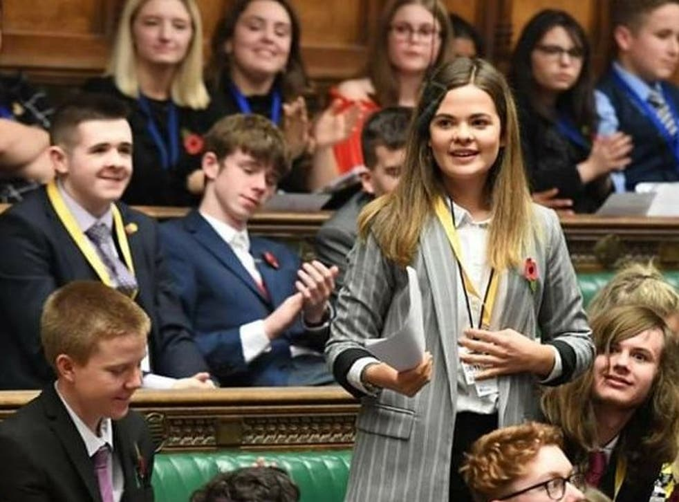 <p>Emma Greenwood speaking in parliament</p>