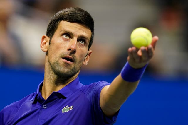 Novak Djokovic overcame an off-court distraction to book his place in the US Open third round (Frank Franklin II/AP)