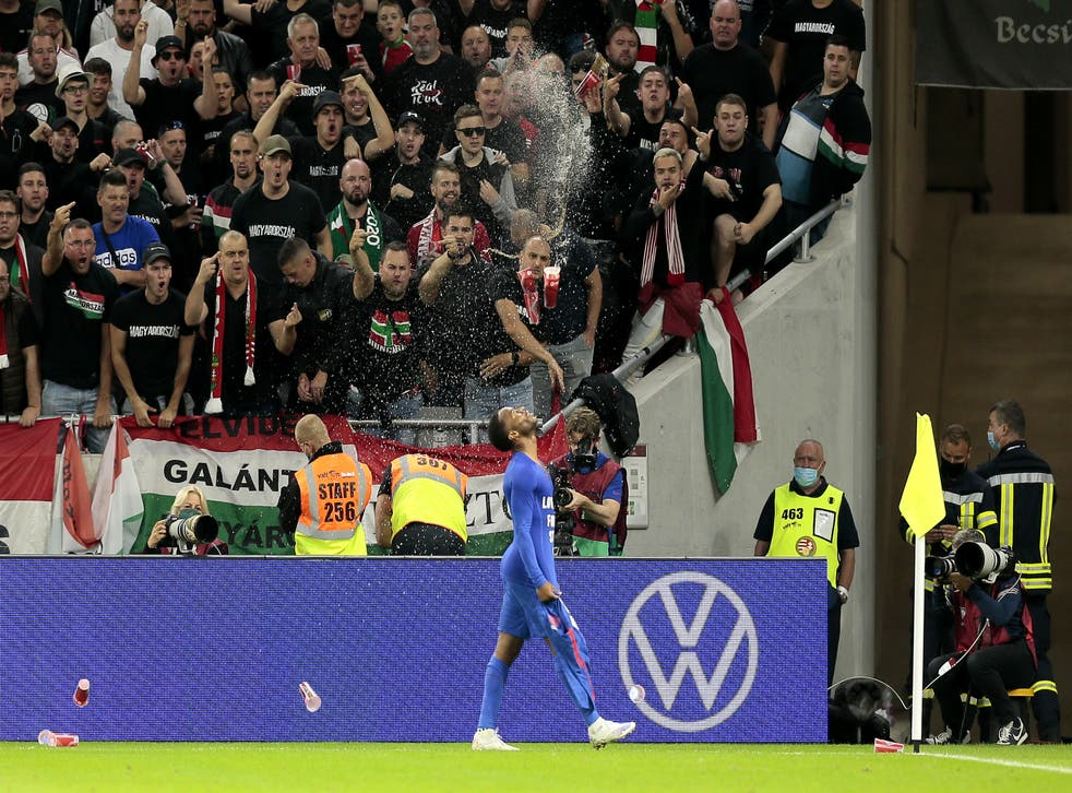 England's Raheem Sterling is abused by Hungary fans after opening the scoring (Attila Trenka/PA).