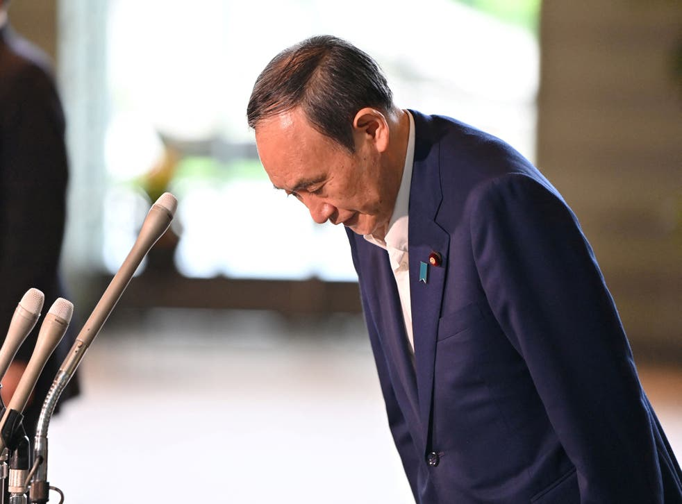 Japanese prime minister Yoshihide Suga to resign after surging Covid cases  | The Independent