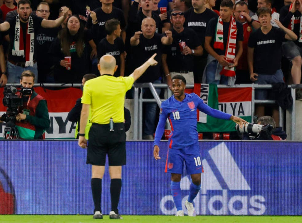 <p>Raheem Sterling speaks to the referee during Thursday's World Cup qualifier in Budapest </p>