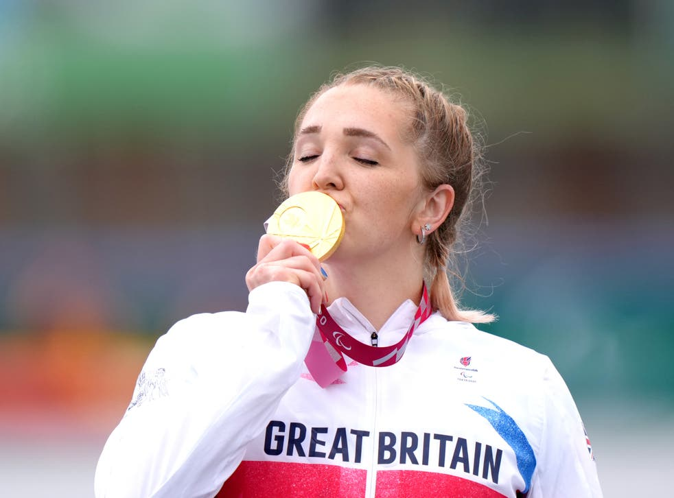 <p>Charlotte Henshaw celebrates with her  Paralympic gold medal</p>