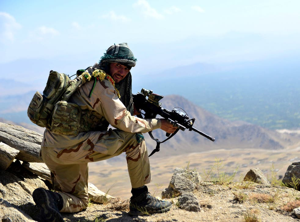 <p>An Afghan resistance fighter takes position in the Panjshir Valley earlier this week</p>