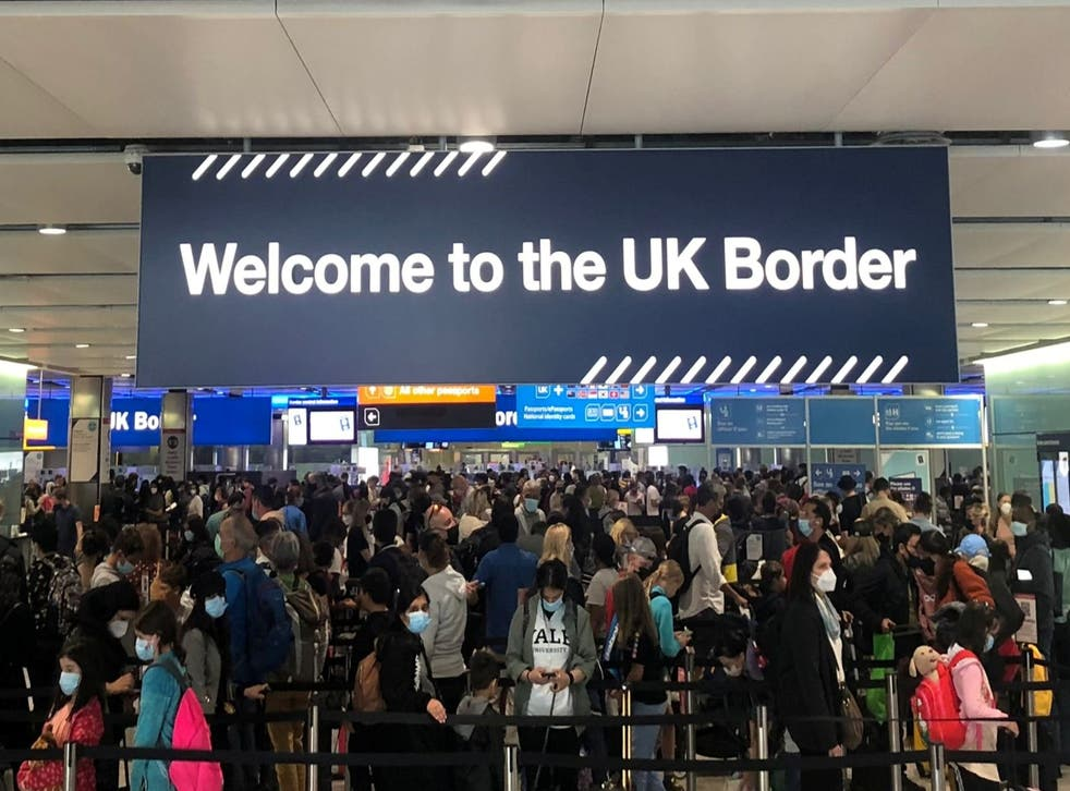 <p>Queues of people wait in line at Heathrow Airport in London on 1 September 2021 </p>