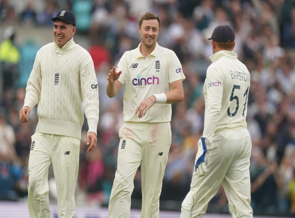Ollie Robinson (centre) celebrates taking the wicket of India's Rohit Sharma (Adam Davy/PA)