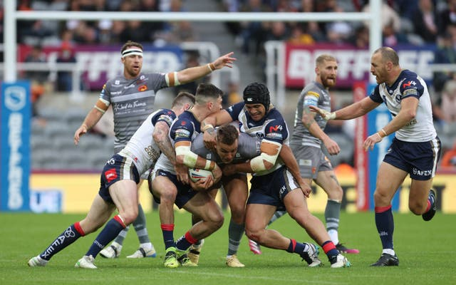 Catalans Dragons' Josh Drinkwater is tackled during the Magic Weekend game with St Helens (Richard Sellers/PA)
