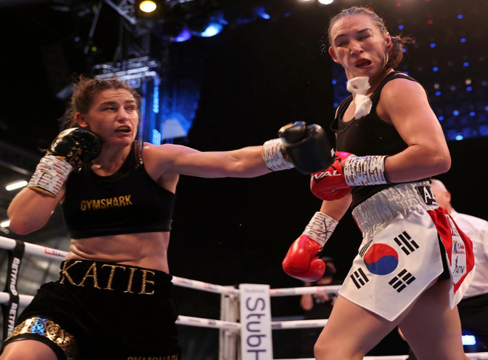 <p>Katie Taylor lands a heavy shot on Jennifer Han</p>