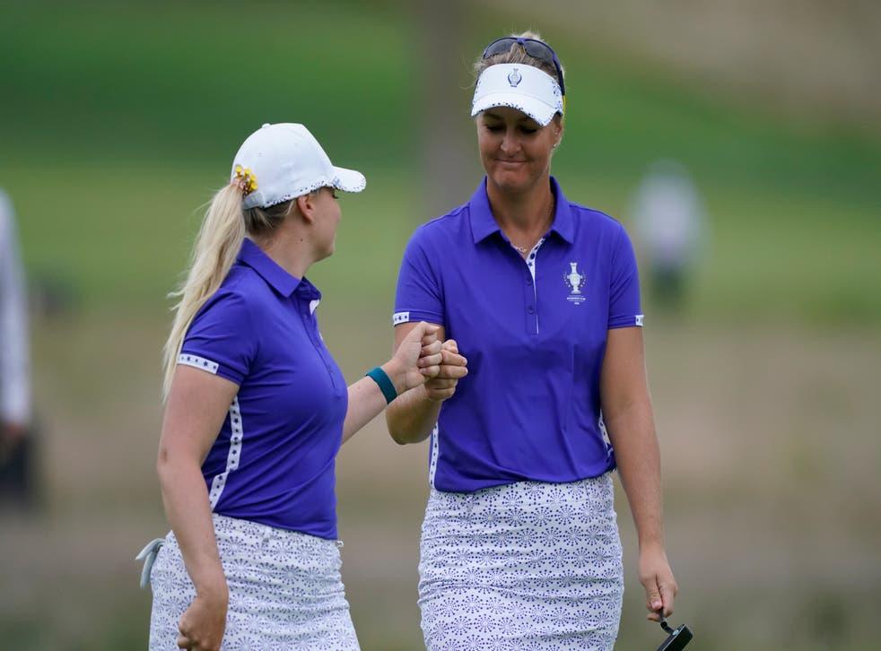 Europe's Matilda Castren, left, Anna Nordqvist celebrate on the third hole (Carlos Osorio/AP)