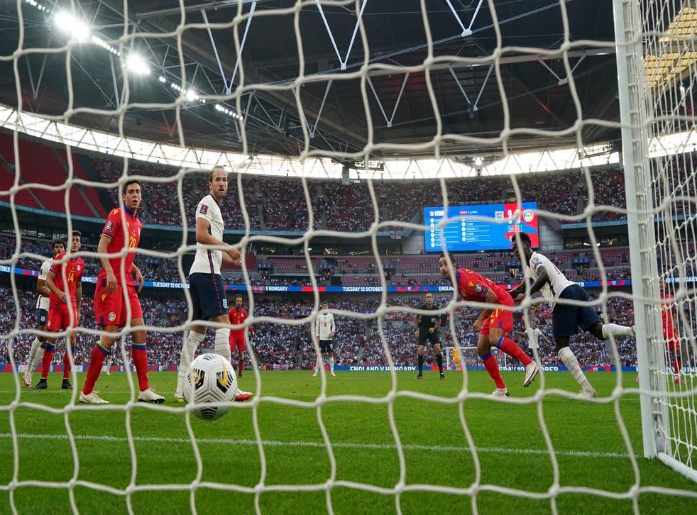 <p>Bukayo Saka heads home England's fourth goal at Wembley on Sunday </p>