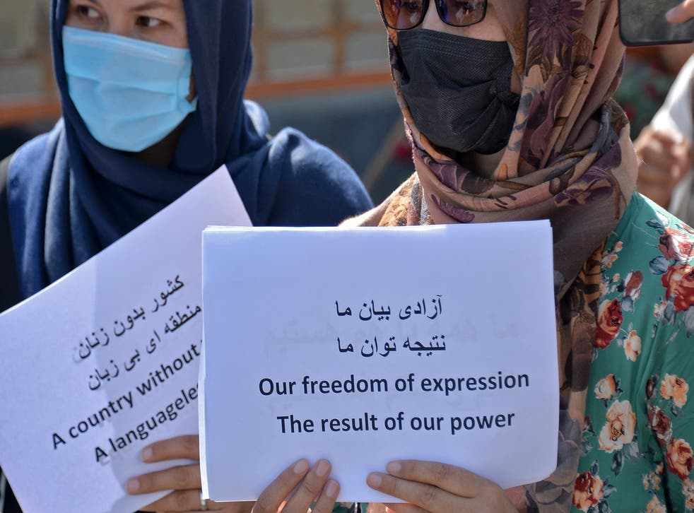<p>Afghan women take part in a protest march for their rights under the Taliban rule in the downtown area of Kabul on 3 September 2021  </p>