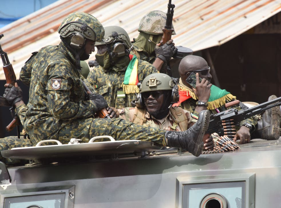 <p>Members of the Guinean military celebrate the arrest of the former president Alpha Conde on Sunday</p>