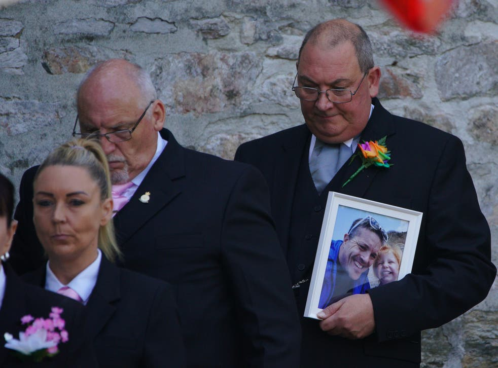 <p>Mourners carrying a photograph of Lee and Sophie Martyn leave the church after the pair's funeral in Plymouth</p>