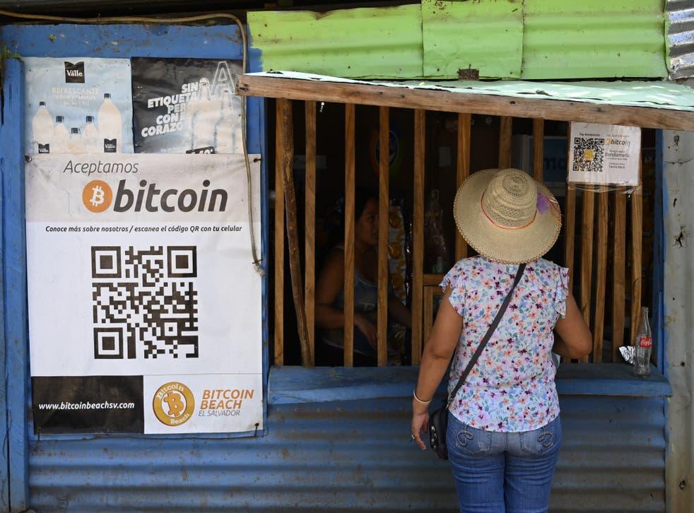 <p>A woman buys from a store that accepts bitcoins in El Zonte, La Libertad, El Salvador </p>