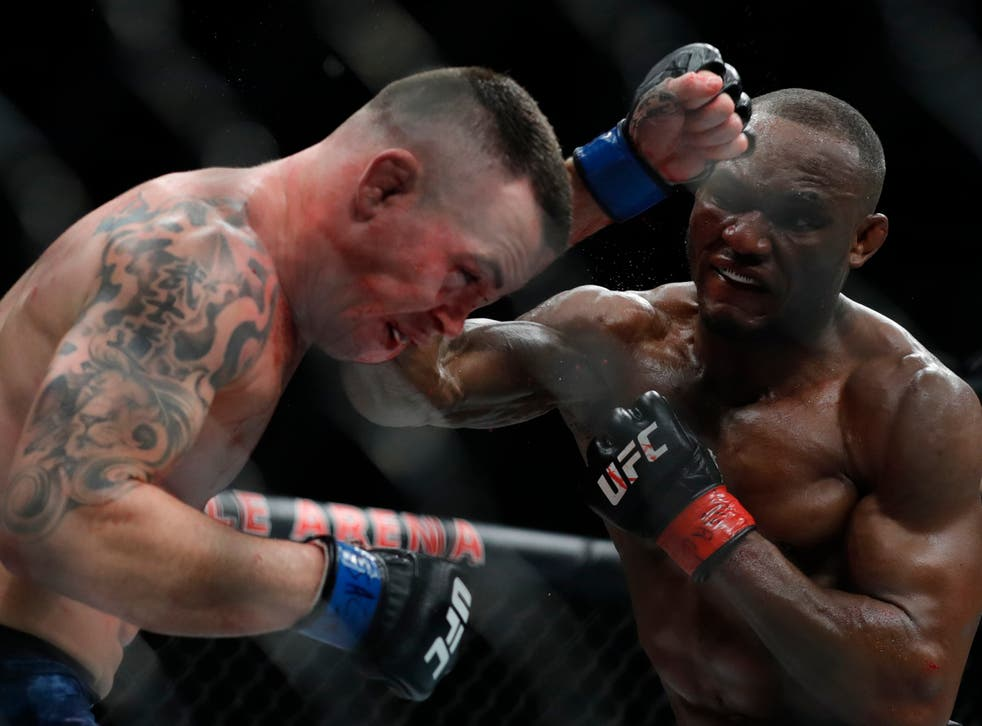 <p>Kamaru Usman (right) will again defend his UFC welterweight title against Colby Covington</p>