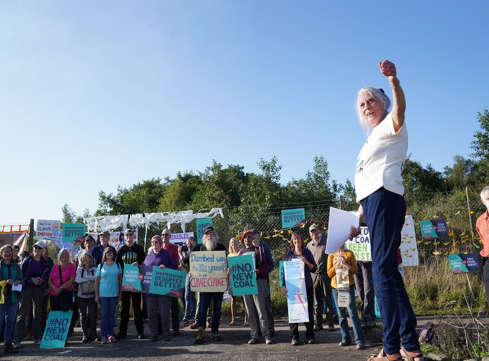 <p>Protesters gather outside the site of the proposed Cumbria coal mine on 7 September, 2021. </p>