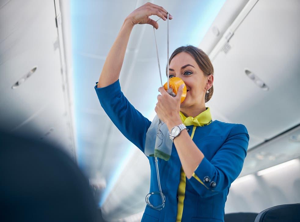 <p>An air steward 'dances' onboard a commercial flight</p>