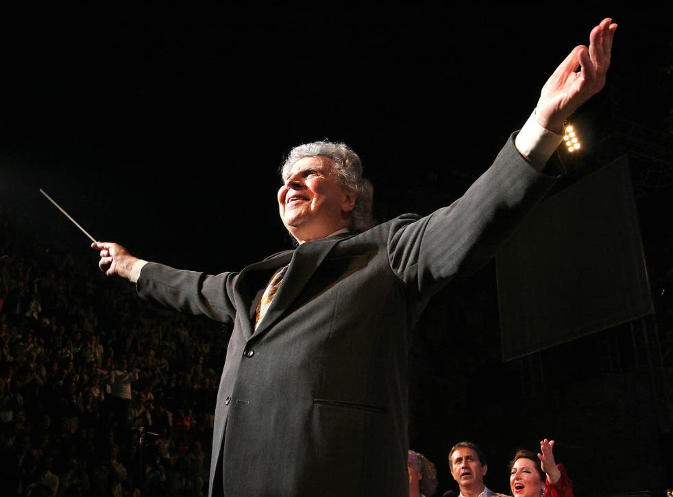 <p>Theodorakis directing his orchestra during a gala concert at the Herodes Atticus Ancient Theatre in Athens</p>