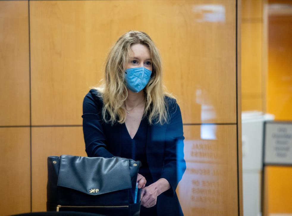 <p>Theranos founder Elizabeth Holmes collects her belongings after going through security at the Robert F. Peckham Federal Building with her defense team on August 31, 2021 in San Jose, California</p>