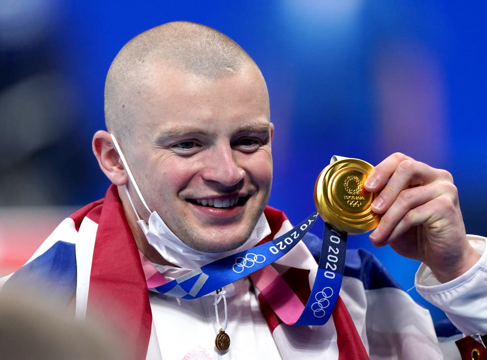 Adam Peaty with his 100m breastroke gold medal at the Tokyo Olympics (Adam Davy/PA).