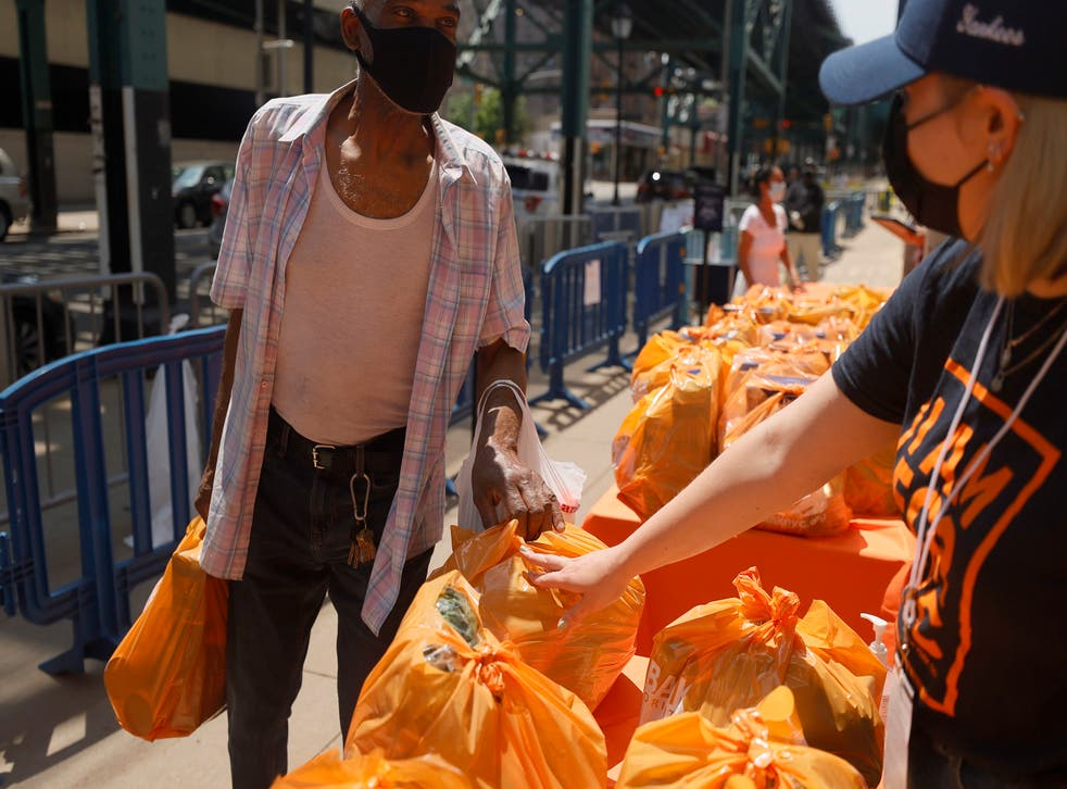 <p> Local residents receive food items as Food Bank For New York City teams up with the New York Yankees to kick-off monthly food distribution for New Yorkers in need at Yankee Stadium on May 20, 2021 in New York City. </p>