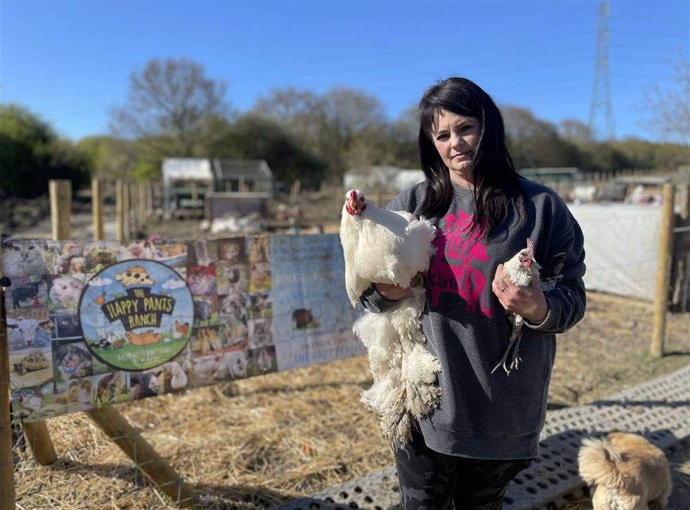 <p>Founder Amey James, with cockerels, at The Happy Pants Ranch animal sanctuary at Bobbing</p>
