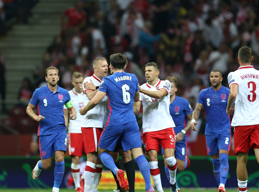 <p>Teammates attempt to separate Harry Maguire and Kamil Glik</p>