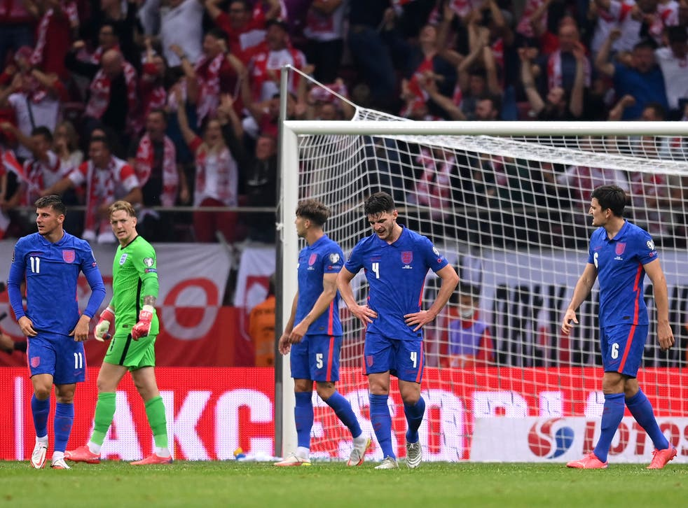 <p>England players react to Poland's late equaliser in Warsaw</p>