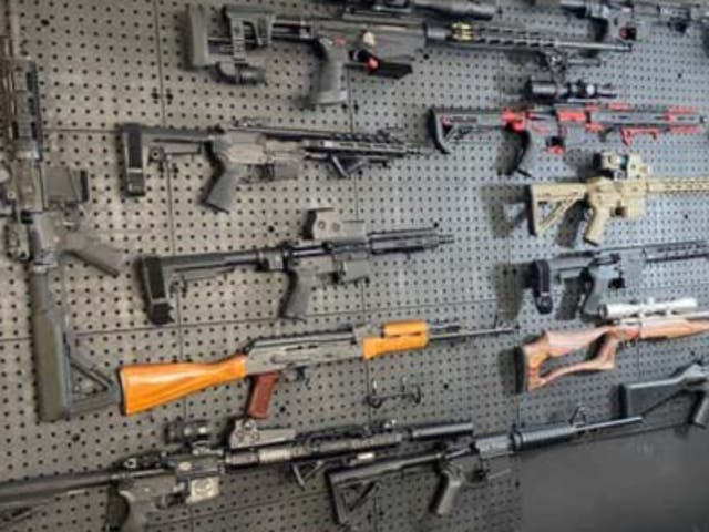 <p>Weapons allegedly found mounted in the 'gun room' of Brian Downey, deputy mayor of Airmont in New York State</p>