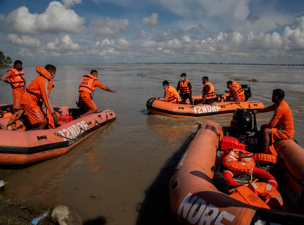 <p>National Disaster Response Force personnel search for missing people after two passenger ferries collided Wednesday in the river Brahmaputra, near Nimati Ghat, in Jorhat, about 350 kilometres (220 miles) from Gauhati, Assam state, India, Thursday, 9 September 2021</p>