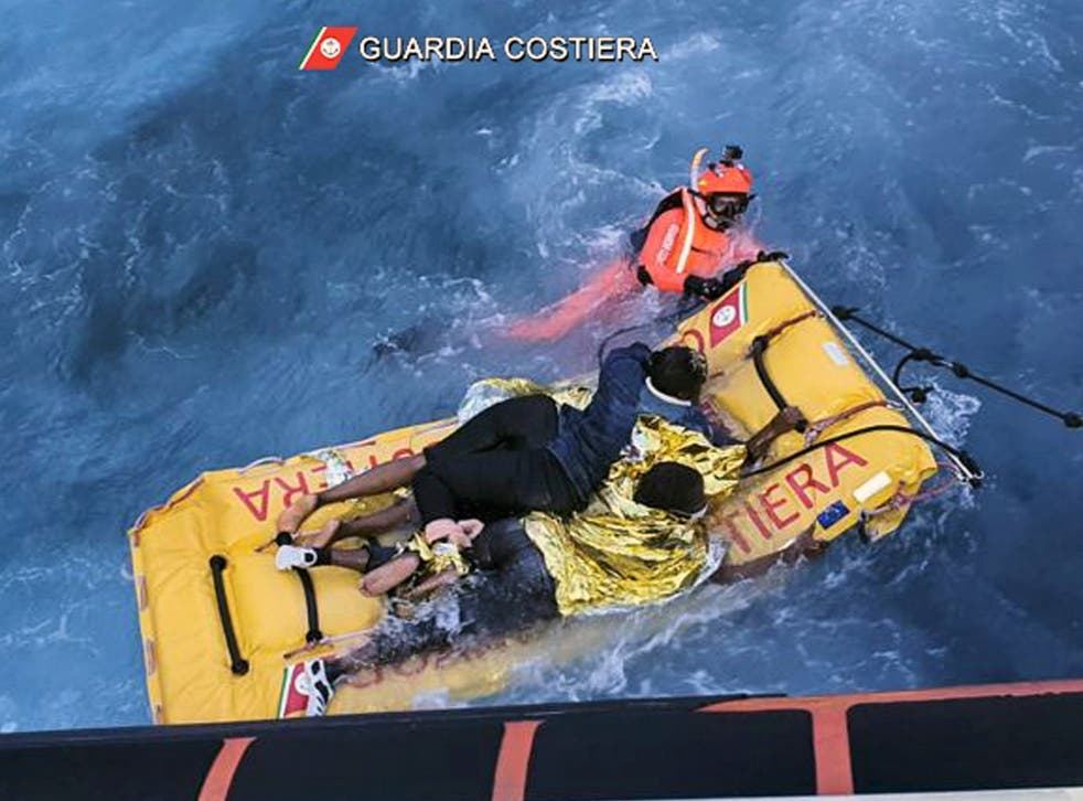 <p>The Italian coast guard uses an inflatable raft to rescue migrants stuck on the shore of the Isola dei Conigli island</p>