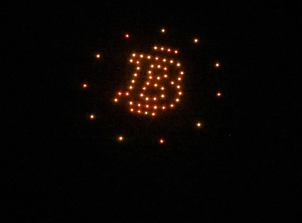 <p>Illuminated drones form figures inspired by the bitcoin logo at a reception hosted by American cryptocurrency developer and billionaire Brock Pierce on the first day of bitcoin's implementation as a currency in El Salvador, in El Sunzal Beach on 7 September, 2021</p>