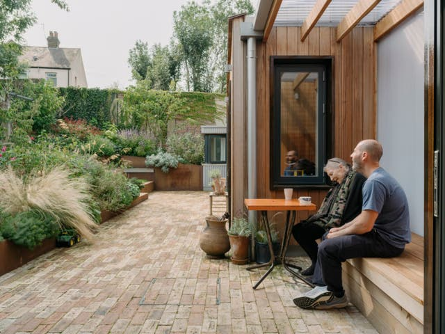<p>Christine and Ben Magid surrounded by lovely old trees in the terraced garden</p>