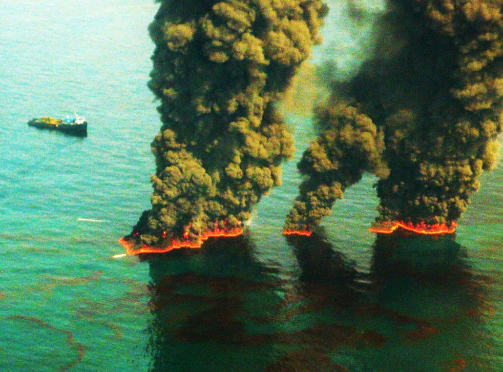 <p>Plumes of smoke rise from a controlled burn during the Deepwater Horizon oil spill in 2010</p>