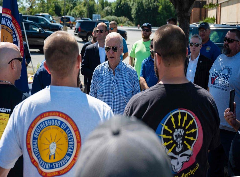 <p>President Joe Biden speaks with union workers as he visits the International Brotherhood of Electric Workers (IBEW) Local 313 in Newcastle, Delaware on September 6, 2021</p>