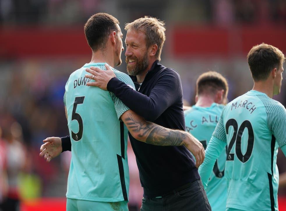 Graham Potter hugs Brighton defender Lewis Dunk after their 1-0 win at Brentford (Dominic Lipinski/PA)