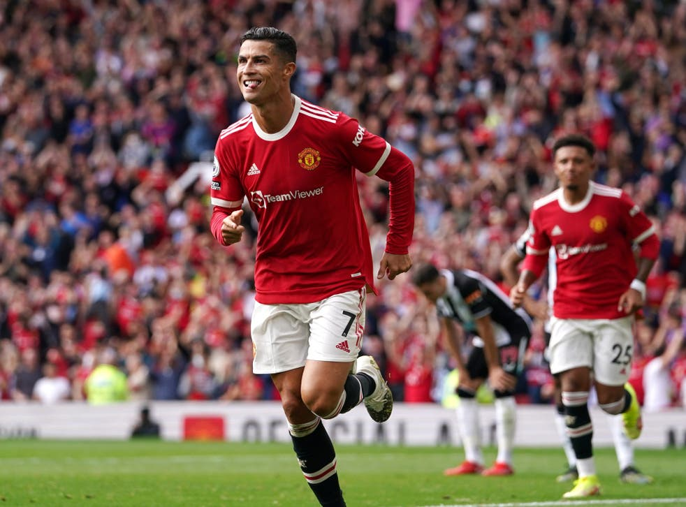 Cristiano Ronaldo celebrates his opener against Newcastle (Martin Rickett/PA)