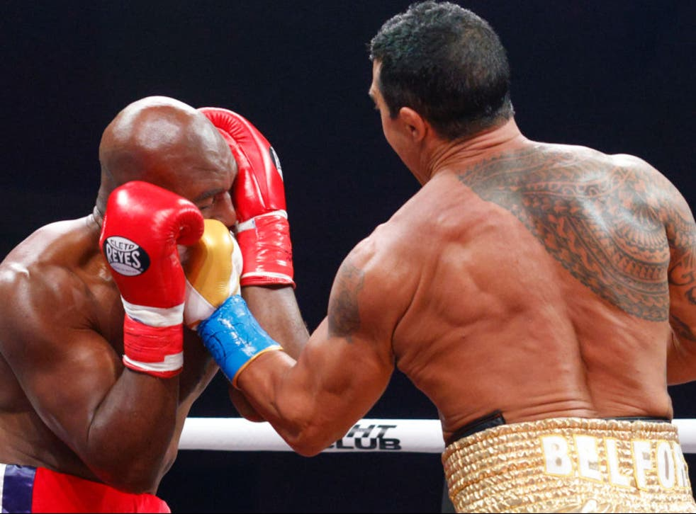 <p>Vitor Belfort punches Evander Holyfield</p>