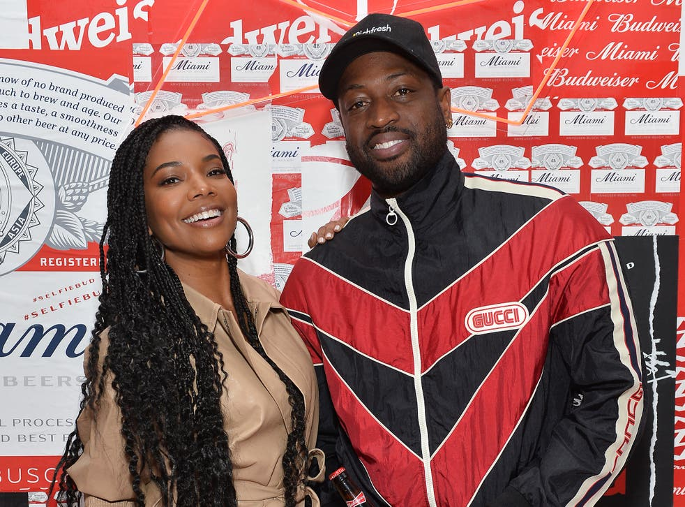 <p>Gabrielle Union and husband Dwayne Wade in February 2020</p>