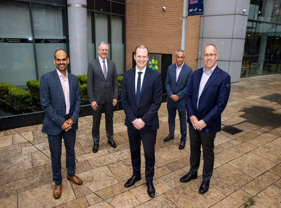 (L-R) Belfast site lead Thomas Raju, Invest NI chief executive Kevin Holland, Economy Minister Gordon Lyons, NI Economy Minister, Agio managing director of cybersecurity Ray Hallen, and chief revenue officer Garvin McKee (Liam McBurney/PA)
